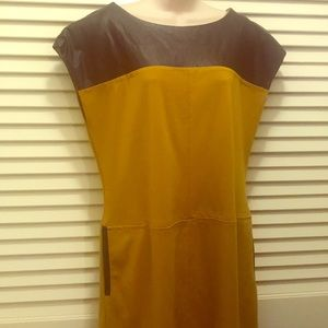 Mustard and brown dress with brown trim pockets
